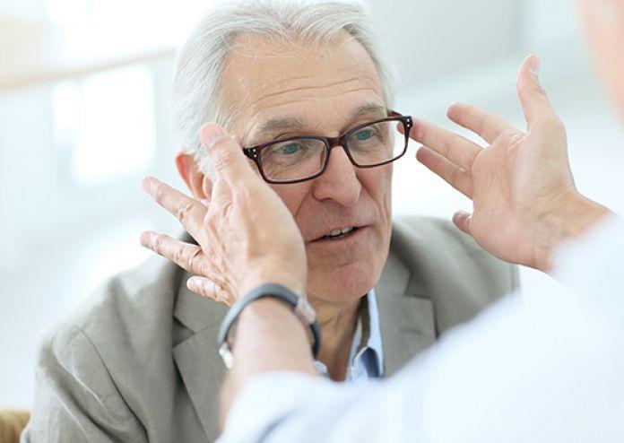 Presbyope patient wears progressive lenses in optical shop